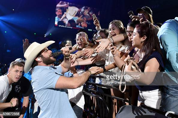 Musician Thomas Rhett performs onstage during the 2016 iHeartCountry Festival at The Frank Erwin Center on April 30 2016 in Austin Texas