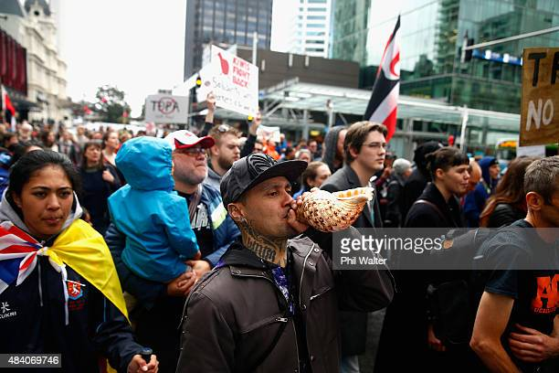 Musician Tiki Taane joins an anti TPPA protest march down Queen Street on August 15 2015 in Auckland New Zealand The TransPacific Partnership...