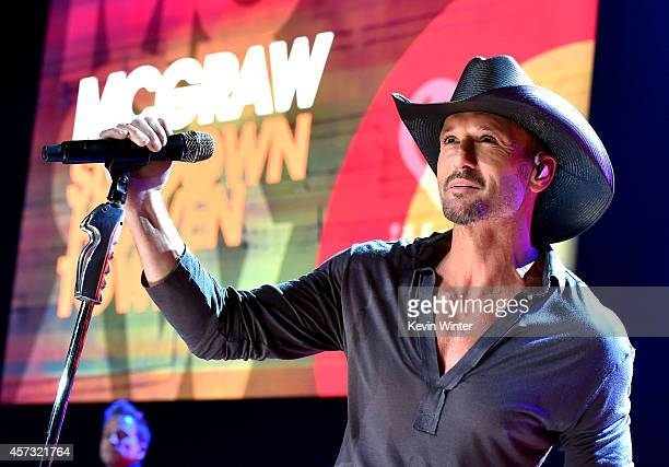 Musician Tim McGraw performs onstage during the iHeartRadio Album Release Party with Tim McGraw at the iHeartRadio Theater on October 15 2014 in...