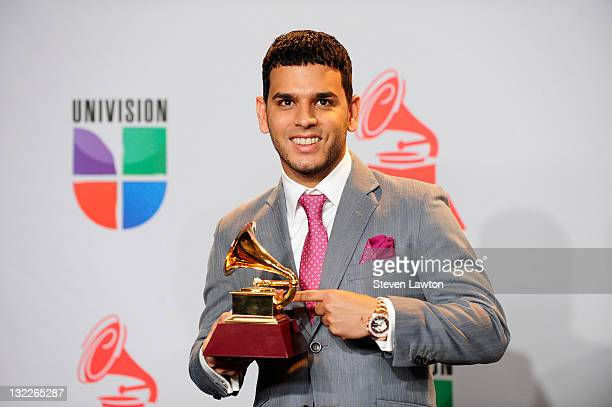 Musician Tito El Bambino winner of Best Contemporary Tropical Album poses in the press room during the 12th annual Latin GRAMMY Awards at the...