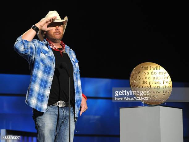 Musician Toby Keith accepts USO award onstage during ACM Presents An AllStar Salute To The Troops at the MGM Grand Garden Arena on April 7 2014 in...