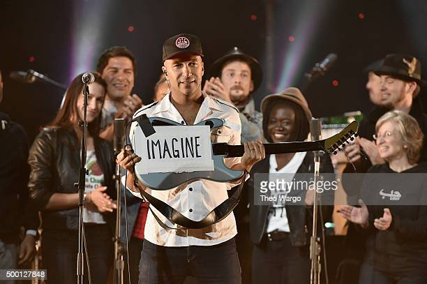 Musician Tom Morello performs on stage during the Imagine John Lennon 75th Birthday Concert at The Theater at Madison Square Garden on December 5...