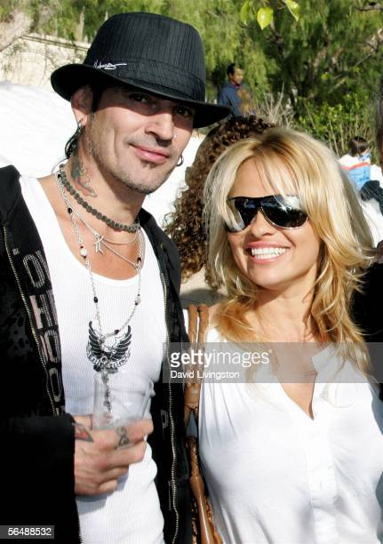 Musician Tommy Lee and actress Pamela Anderson pose at the home of John Paul DeJoria CEO and cofounder of John Paul Mitchell Haircare Systems during...