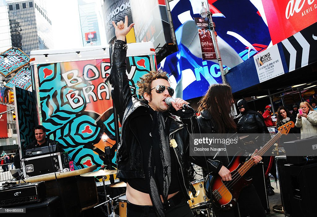 Musician Tommy London of the band 'The Dirty Pearls' performs at Lady Gaga's Born Brave Bus Tour at Times Square on March 23, 2013 in New York City.