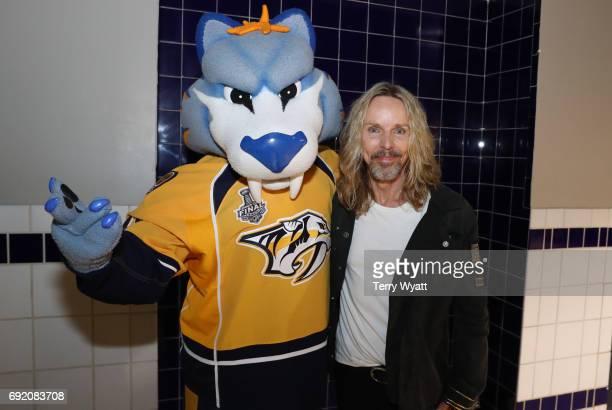 Musician Tommy Shaw with Nashville Predators mascot 'Gnash' at the Stanley Cup Finals Game 3 Nashville Predators Vs Pittsburgh Penguins at...