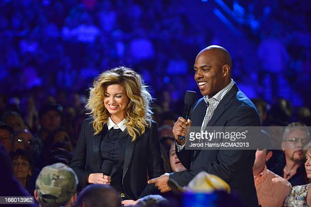 Musician Tori Kelly and presenter Kevin Frazier onstage during the 48th Annual Academy Of Country Music Awards ACM Fan Jam at Orelans Arena on April...
