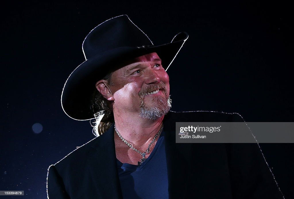 Musician <a gi-track='captionPersonalityLinkClicked' href=/galleries/search?phrase=Trace+Adkins&family=editorial&specificpeople=224686 ng-click='$event.stopPropagation()'>Trace Adkins</a> looks on during a campaign rally for Republican presidential candidate, former Massachusetts Gov. Mitt Romney at the Augusta Expoland on October 4, 2012 in Fishersville, Virginia. One day after the first Presidential debate, Mitt Romney spoke to the CPAC before heading to Virginia to campaign with his running mate Rep Paul Ryan (R-WI).