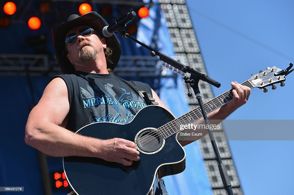 Musician <a gi-track='captionPersonalityLinkClicked' href=/galleries/search?phrase=Trace+Adkins&family=editorial&specificpeople=224686 ng-click='$event.stopPropagation()'>Trace Adkins</a> performs at iHeartRadio and Coca-Cola's Open For Summer Concert on May 24, 2013 in Charlotte, North Carolina. The concert kicks off Coke's Open For Summer initiative, which helps families get out and get active all season long through prize giveaways – such as tickets, gift cards and once-in-a-lifetime experiences – which can be won on MyCokeRewards.com. The Open For Summer Kickoff Concert will stream across more than 100 Clear Channel Mainstream Country stations nationwide and on iHeartRadio's Country Road Radio during a 60-minute Memorial Day special broadcast.