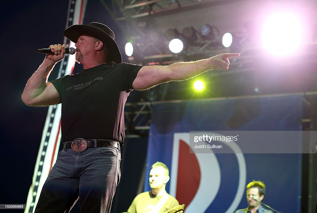 Musician <a gi-track='captionPersonalityLinkClicked' href=/galleries/search?phrase=Trace+Adkins&family=editorial&specificpeople=224686 ng-click='$event.stopPropagation()'>Trace Adkins</a> performs during a campaign rally for Republican presidential candidate, former Massachusetts Gov. Mitt Romney at the Augusta Expoland on October 4, 2012 in Fishersville, Virginia. One day after the first Presidential debate, Mitt Romney spoke to the CPAC before heading to Virginia to campaign with his running mate Rep Paul Ryan (R-WI).