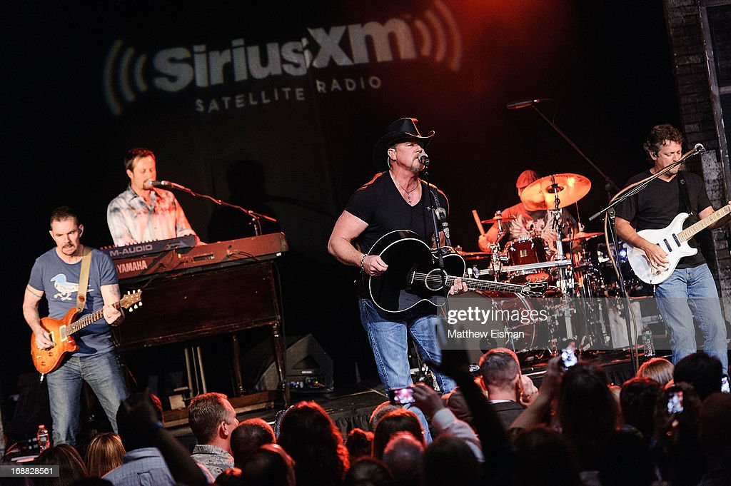 Musician <a gi-track='captionPersonalityLinkClicked' href=/galleries/search?phrase=Trace+Adkins&family=editorial&specificpeople=224686 ng-click='$event.stopPropagation()'>Trace Adkins</a> performs live during 'SirusXM Sounds Of Summer' Series at Hard Rock Cafe New York on May 15, 2013 in New York City.