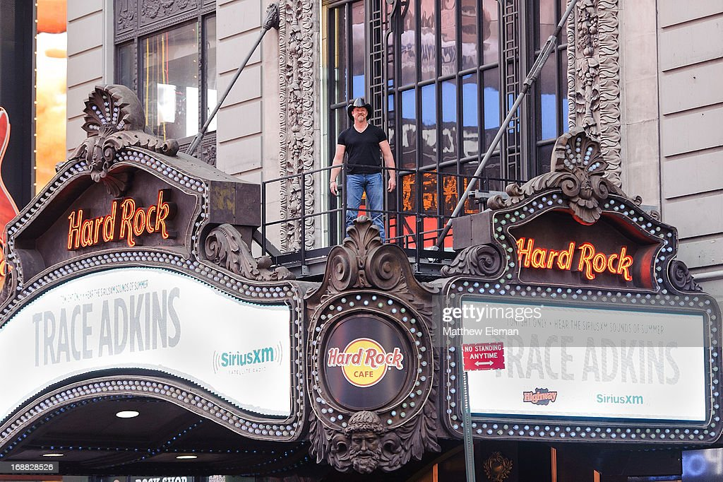 Musician Trace Adkins stands on the Hard Rock Cafe's marquee during 'SirusXM Sounds Of Summer' Series at Hard Rock Cafe New York on May 15, 2013 in New York City.
