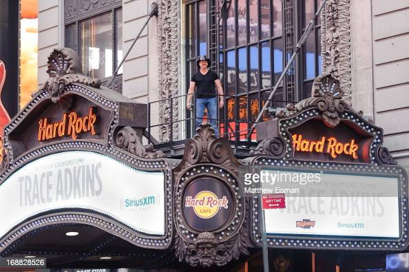Musician Trace Adkins stands on the Hard Rock Cafe's marquee during 'SirusXM Sounds Of Summer' Series at Hard Rock Cafe New York on May 15 2013 in...