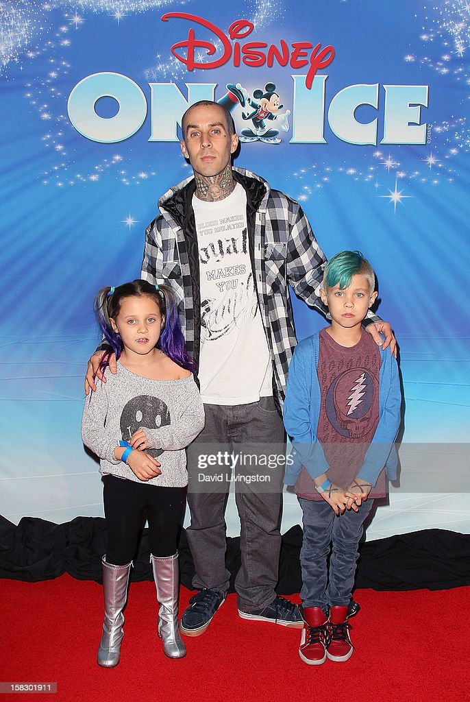 Musician <a gi-track='captionPersonalityLinkClicked' href=/galleries/search?phrase=Travis+Barker&family=editorial&specificpeople=213206 ng-click='$event.stopPropagation()'>Travis Barker</a> (C) and children Alabama Luella Barker (L) and Landon Asher Barker (R) attend the opening night of Disney On Ice's 'Dare To Dream' at LA Kings Holiday Ice at L.A. LIVE on December 12, 2012 in Los Angeles, California.