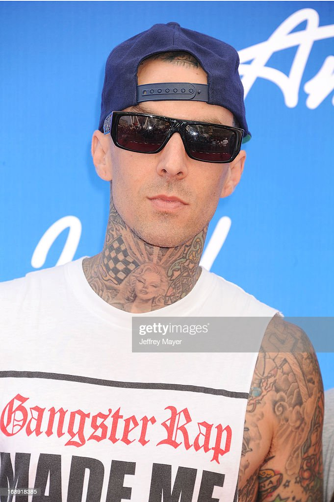 Musician <a gi-track='captionPersonalityLinkClicked' href=/galleries/search?phrase=Travis+Barker&family=editorial&specificpeople=213206 ng-click='$event.stopPropagation()'>Travis Barker</a> arrives at FOX's 'American Idol' Grand Finale at Nokia Theatre L.A. Live on May 16, 2013 in Los Angeles, California.