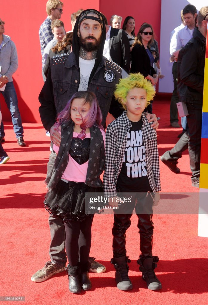 Musician <a gi-track='captionPersonalityLinkClicked' href=/galleries/search?phrase=Travis+Barker&family=editorial&specificpeople=213206 ng-click='$event.stopPropagation()'>Travis Barker</a>, children Alabama Luella Barker and Landon Asher Barker arrive at the Los Angeles premiere of 'The Lego Movie' at Regency Village Theatre on February 1, 2014 in Westwood, California.