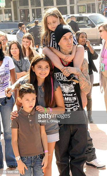 Musician Travis Barker daughter Alabama son Landon and stepdaughter Atiana attend the 'Puss In Boots' Los Angeles Premiere at Regency Village Theatre...