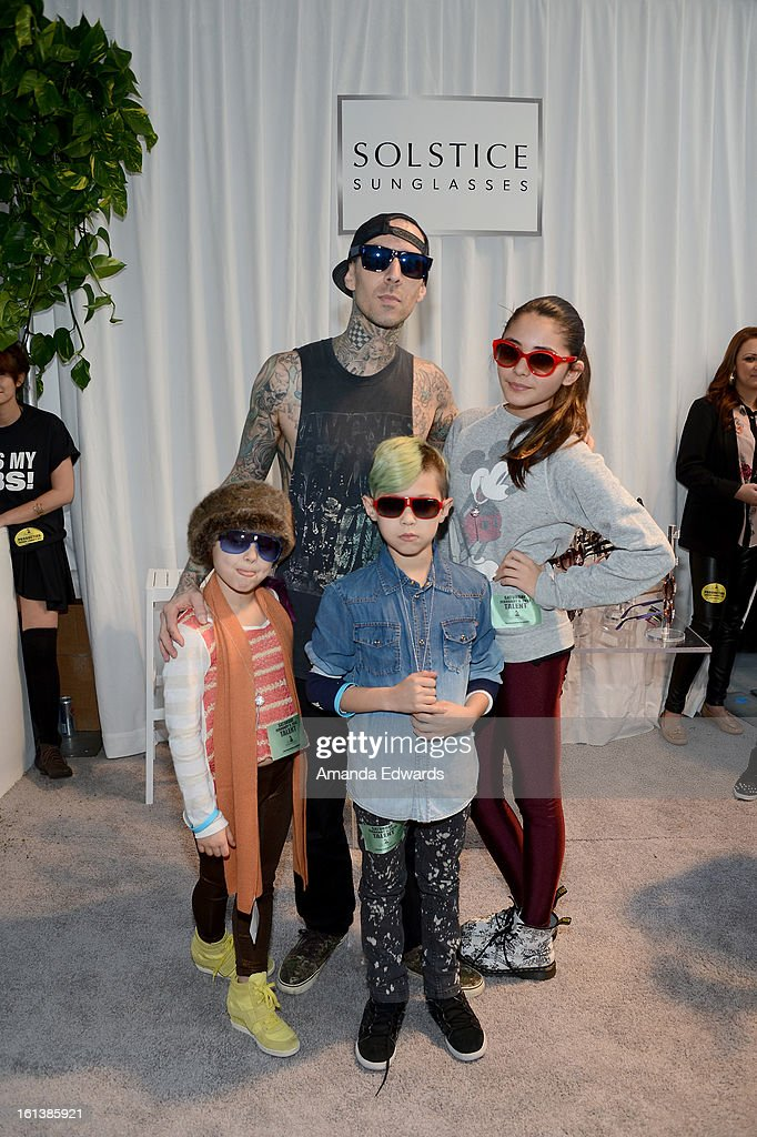 Musician Travis Barker in Carrera CA5002S and family pose with SOLSTICE Sunglasses and Safilo USA during the 55th Annual GRAMMY Awards at the STAPLES Center on February 9, 2013 in Los Angeles, California.