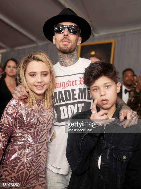 Musician Travis Barker of Blink182 with children Alabama Barker and Landon Barker attend The 59th GRAMMY Awards at STAPLES Center on February 12 2017...