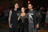 Musician Travis Barker recording artist Demi Lovato and actor Wilmer Valderrama pose backstage during the Vevo CERTIFIED SuperFanFest presented by...