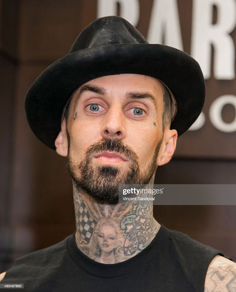 Musician Travis Barker signs his new book 'Can I Say: Living Large, Cheating Death,... Show more - musician-travis-barker-signs-his-new-book-can-i-say-living-large-picture-id493497690