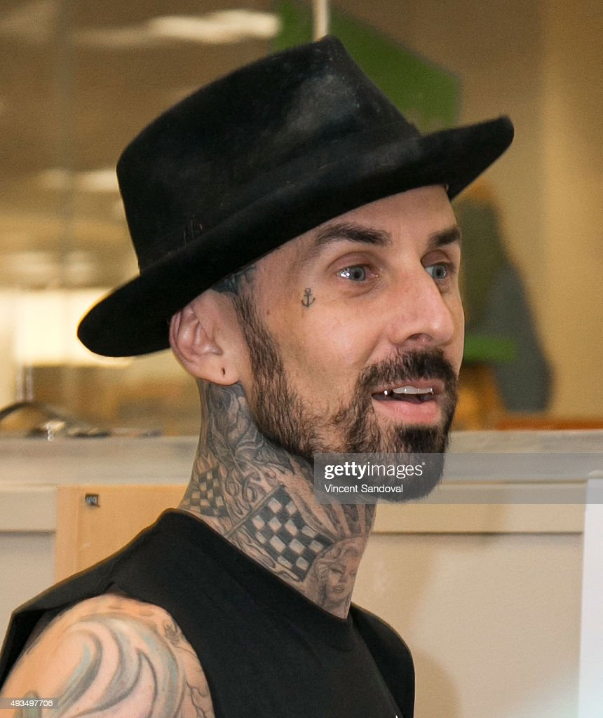 Musician Travis Barker signs his new book 'Can I Say: Living Large, Cheating Death, An... Show more - musician-travis-barker-signs-his-new-book-can-i-say-living-large-picture-id493497706