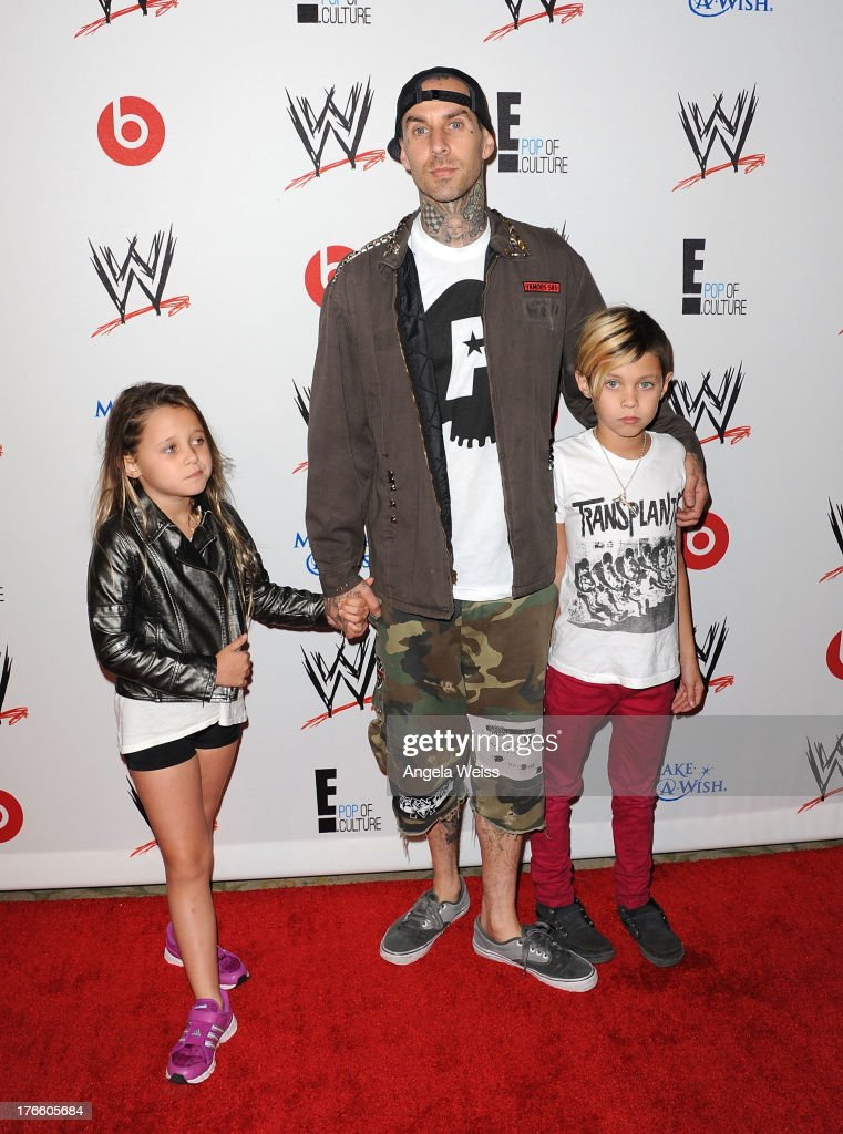 Musician <a gi-track='captionPersonalityLinkClicked' href=/galleries/search?phrase=Travis+Barker&family=editorial&specificpeople=213206 ng-click='$event.stopPropagation()'>Travis Barker</a> (C) with his kids Alabama Luella Barker (L) and Landon Asher Barker (R) arrive at WWE and E! Entertainment's 'Superstars For Hope' at Beverly Hills Hotel on August 15, 2013 in Beverly Hills, California.