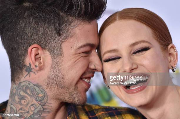 Musician Travis Mills and actress Madelaine Petsch arrive at the 2017 American Music Awards at Microsoft Theater on November 19 2017 in Los Angeles...