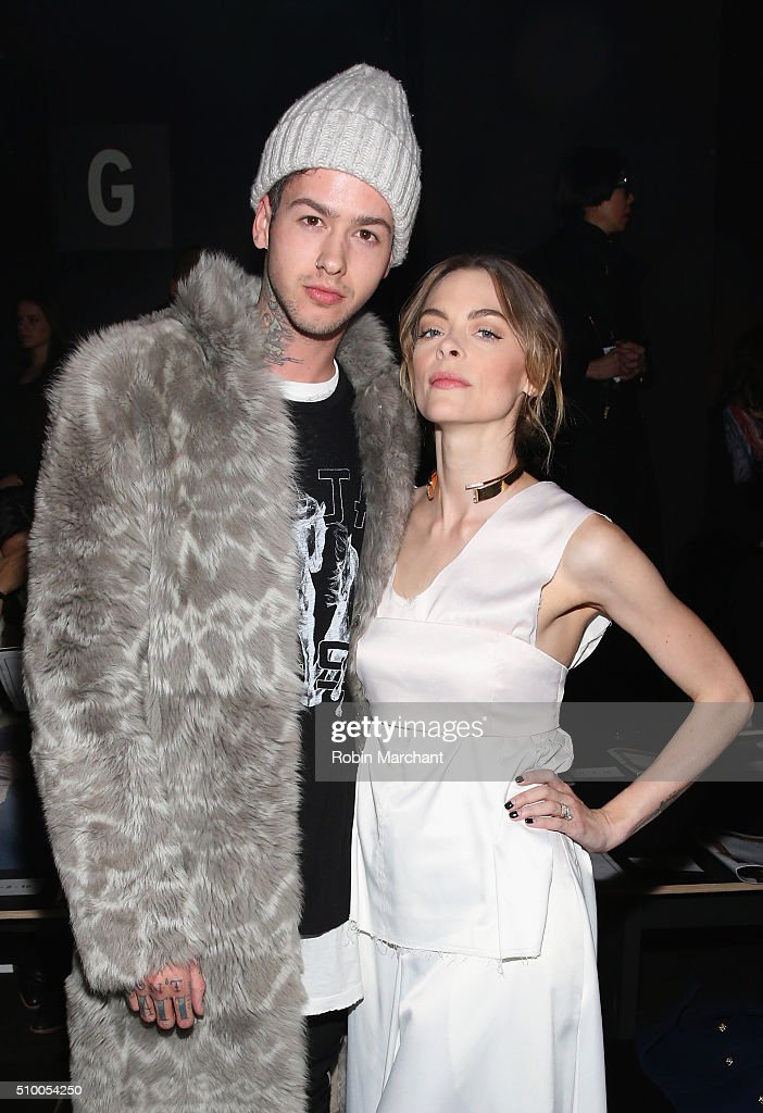 Musician Travis Mills (L) and model <a gi-track='captionPersonalityLinkClicked' href=/galleries/search?phrase=Jaime+King+-+Actress&family=editorial&specificpeople=206809 ng-click='$event.stopPropagation()'>Jaime King</a> attend the Baja East Fall 2016 fashion show during New York Fashion Week: The Shows at The Dock, Skylight at Moynihan Station on February 13, 2016 in New York City.