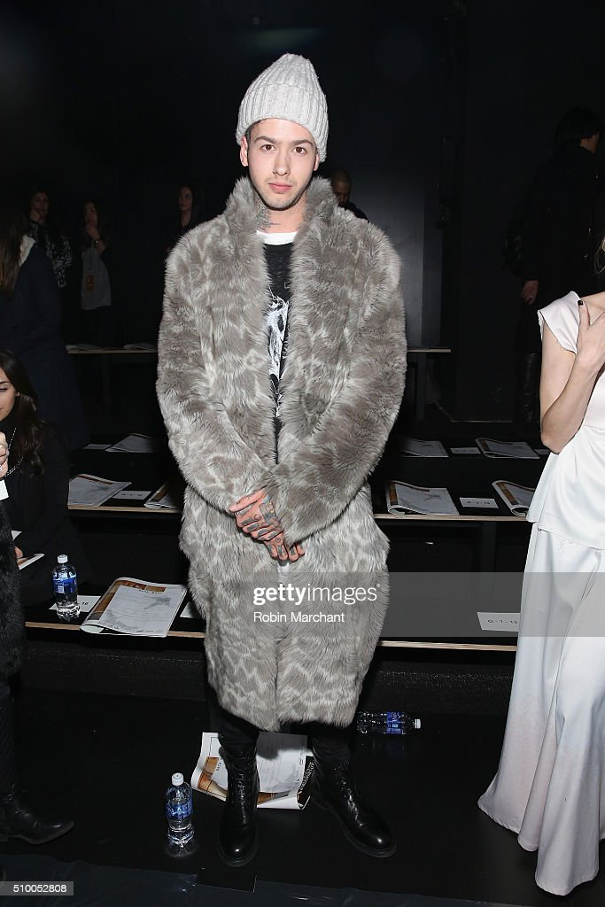 Musician Travis Mills attends the Baja East Fall 2016 fashion show during New York Fashion Week: The Shows at The Dock, Skylight at Moynihan Station on February 13, 2016 in New York City.