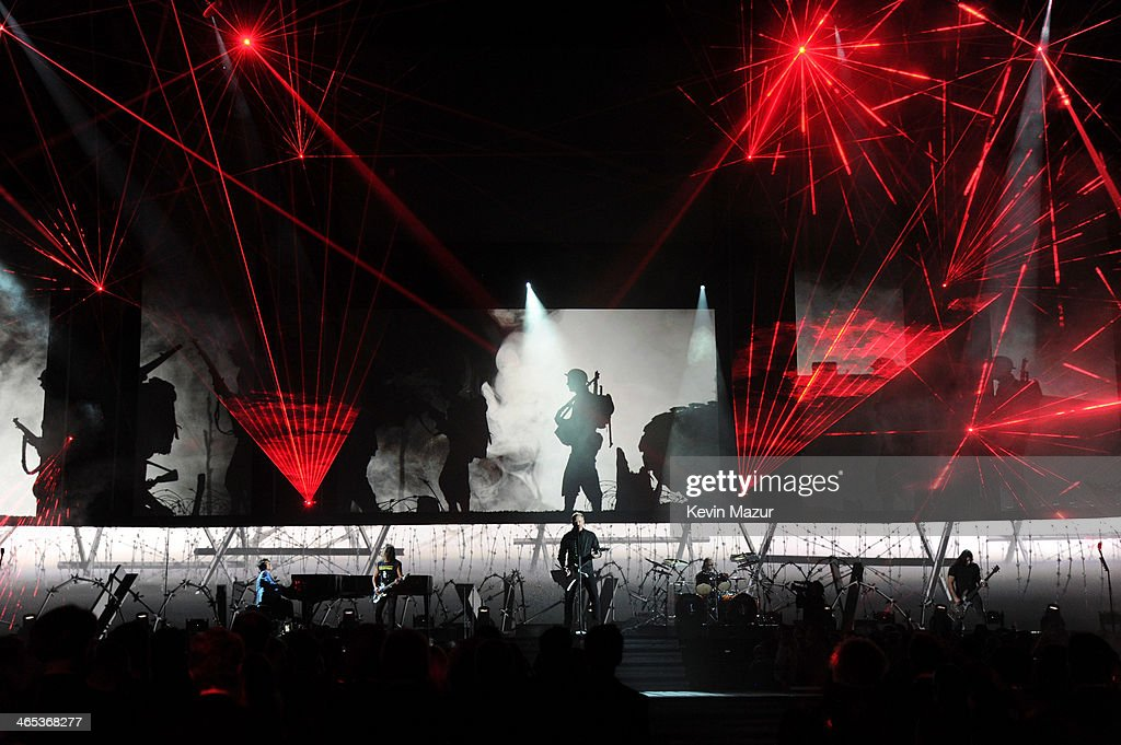 Musician Trent Reznor (C) of <a gi-track='captionPersonalityLinkClicked' href=/galleries/search?phrase=Nine+Inch+Nails&family=editorial&specificpeople=799973 ng-click='$event.stopPropagation()'>Nine Inch Nails</a> onstage during the 56th GRAMMY Awards at Staples Center on January 26, 2014 in Los Angeles, California.