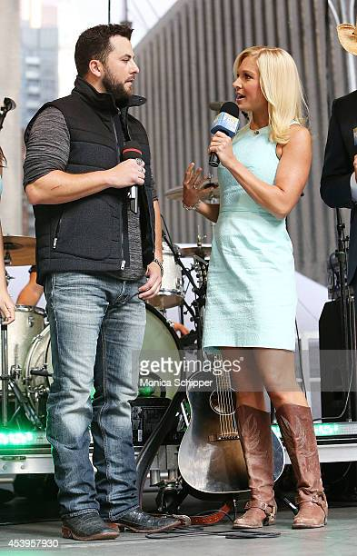Musician Tyler Farr and Anna Kooiman attend 'FOX Friends' All American Concert Series outside of FOX Studios on August 22 2014 in New York City