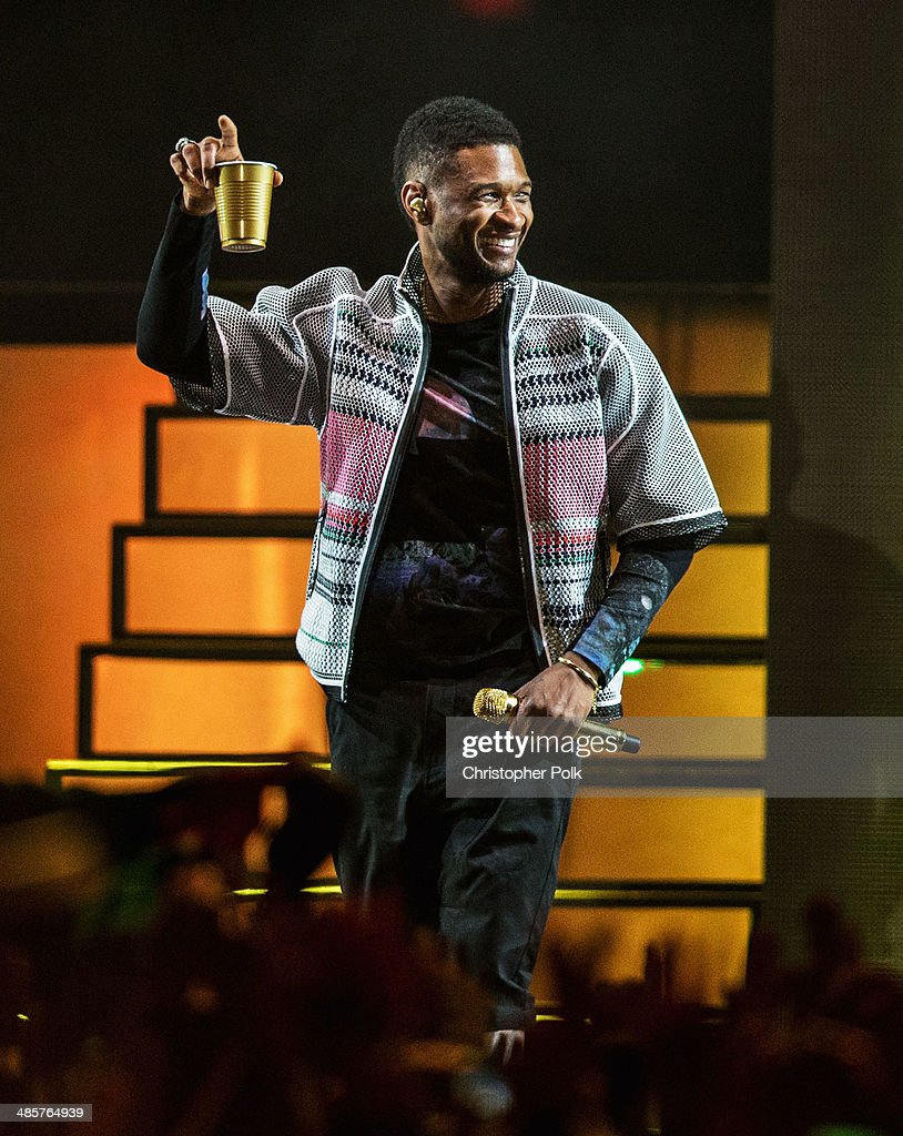 Musician <a gi-track='captionPersonalityLinkClicked' href=/galleries/search?phrase=Usher+-+Singer&family=editorial&specificpeople=201477 ng-click='$event.stopPropagation()'>Usher</a> performs onstage with Pharrell Williams during day 2 of the 2014 Coachella Valley Music & Arts Festival at the Empire Polo Club on April 19, 2014 in Indio, California.