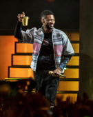 Musician Usher performs onstage with Pharrell Williams during day 2 of the 2014 Coachella Valley Music Arts Festival at the Empire Polo Club on April...
