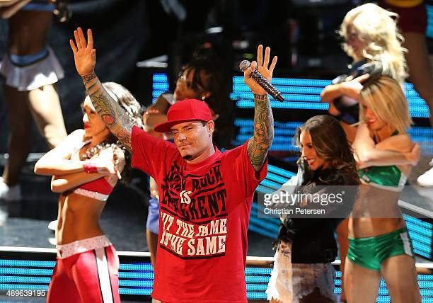 Musician Vanilla Ice performs during the Sprite Slam Dunk Contest 2014 as part of the 2014 NBA AllStar Weekend at the Smoothie King Center on...