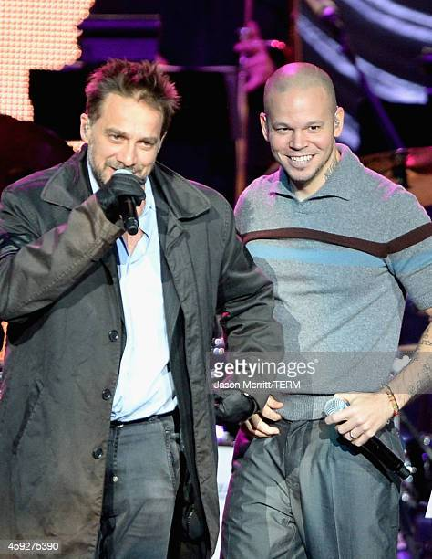 Musician Vicentico and singer Rene Perez Joglar of Calle 13 perform onstage during the 2014 Person of the Year honoring Joan Manuel Serrat at the...