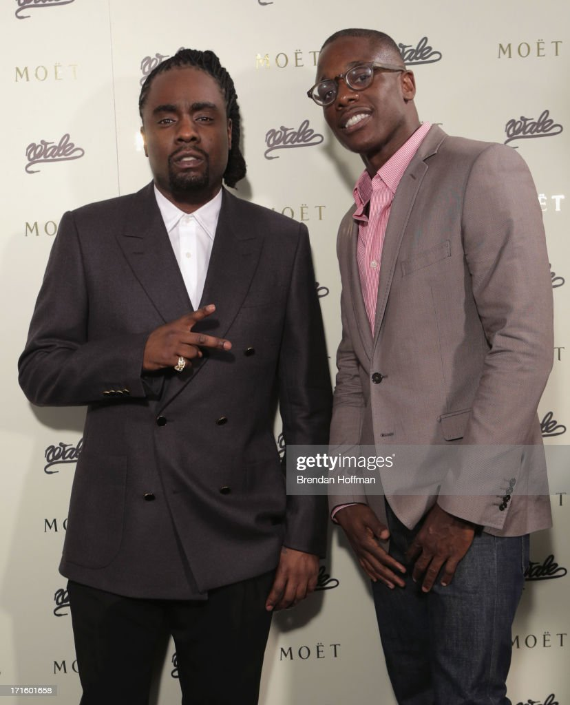 Musician Wale and Moet Chandon Brand Director Keith Howard attend the Moet Rose Lounge DC hosted by Wale to celebrate the release of 'The Gifted' at...