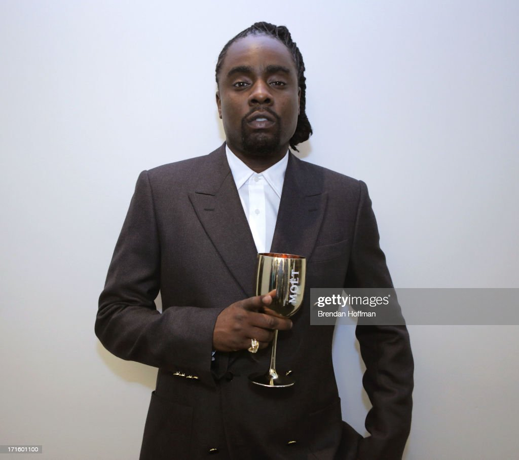 Musician Wale attends the Moet Rose Lounge DC hosted by Wale to celebrate the release of 'The Gifted' at W POV Terrace on June 26 2013 in Washington...