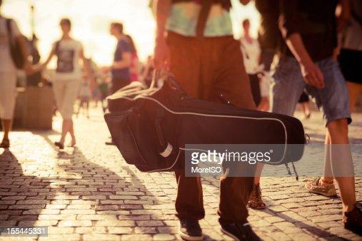 Musician walking on the street