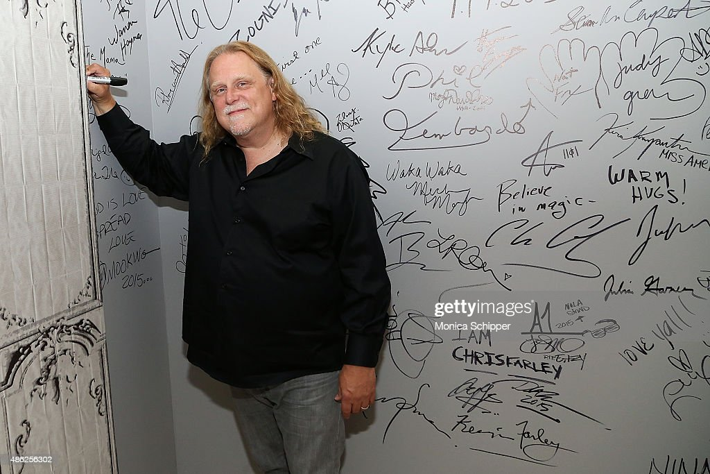 Musician Warren Haynes signs the wall at AOL when he attends AOL BUILD Speaker Series: Warren Haynes Discusses His New Album 'Ashes And Dust' at AOL Studios In New York on September 2, 2015 in New York City.