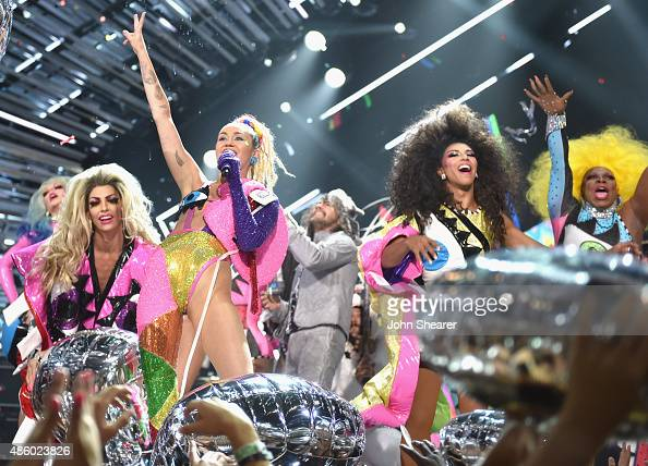 Musician Wayne Coyne of The Flaming Lips and host Miley Cyrus styled by Simone Harouche perform onstage during the 2015 MTV Video Music Awards at...