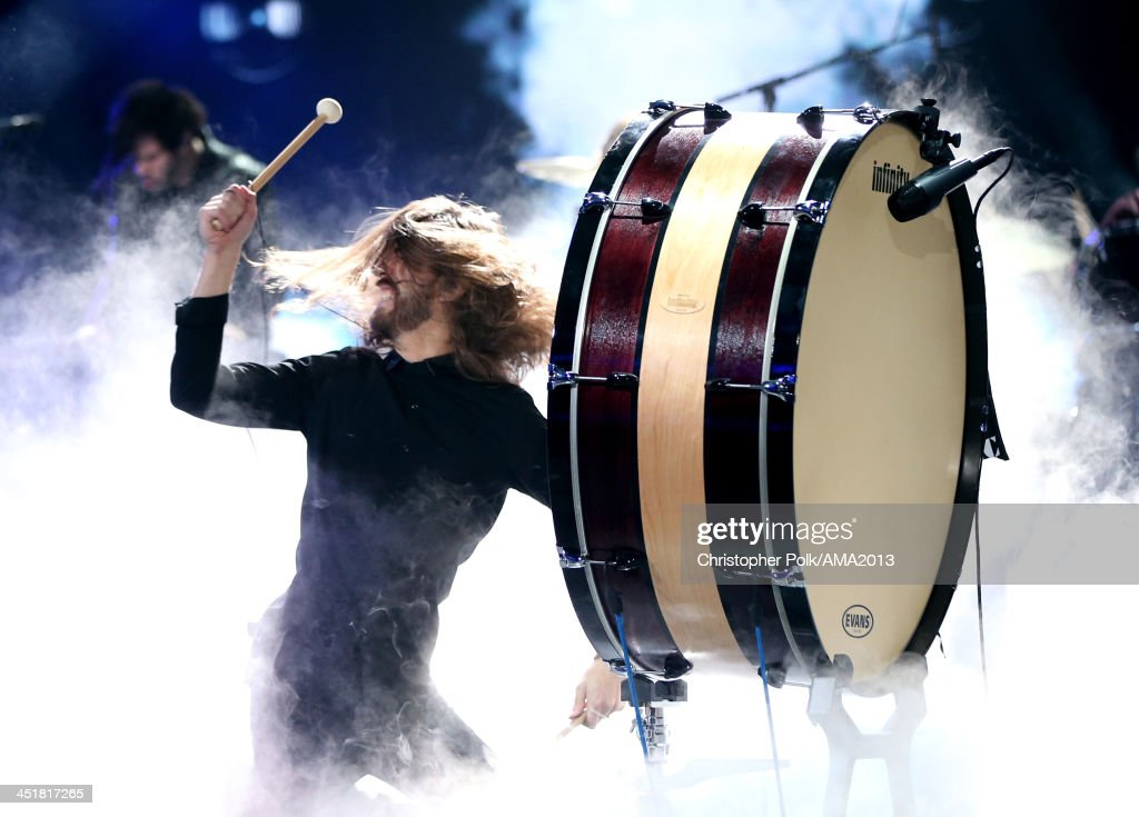 Musician Wayne Sermon of Imagine Dragons performs onstage during the 2013 American Music Awards at Nokia Theatre L.A. Live on November 24, 2013 in Los Angeles, California.