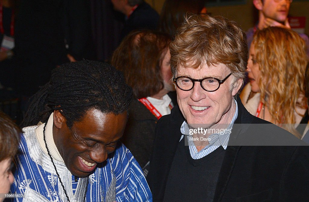 Musician Willi Calhoun and President and Founder of the Sundance Film Festival Robert Redford attend An Artist At The Table, a benefit for the Sundance Institute during the 2013 Sundance Film Festival at The Shop on January 17, 2013 in Park City, Utah.
