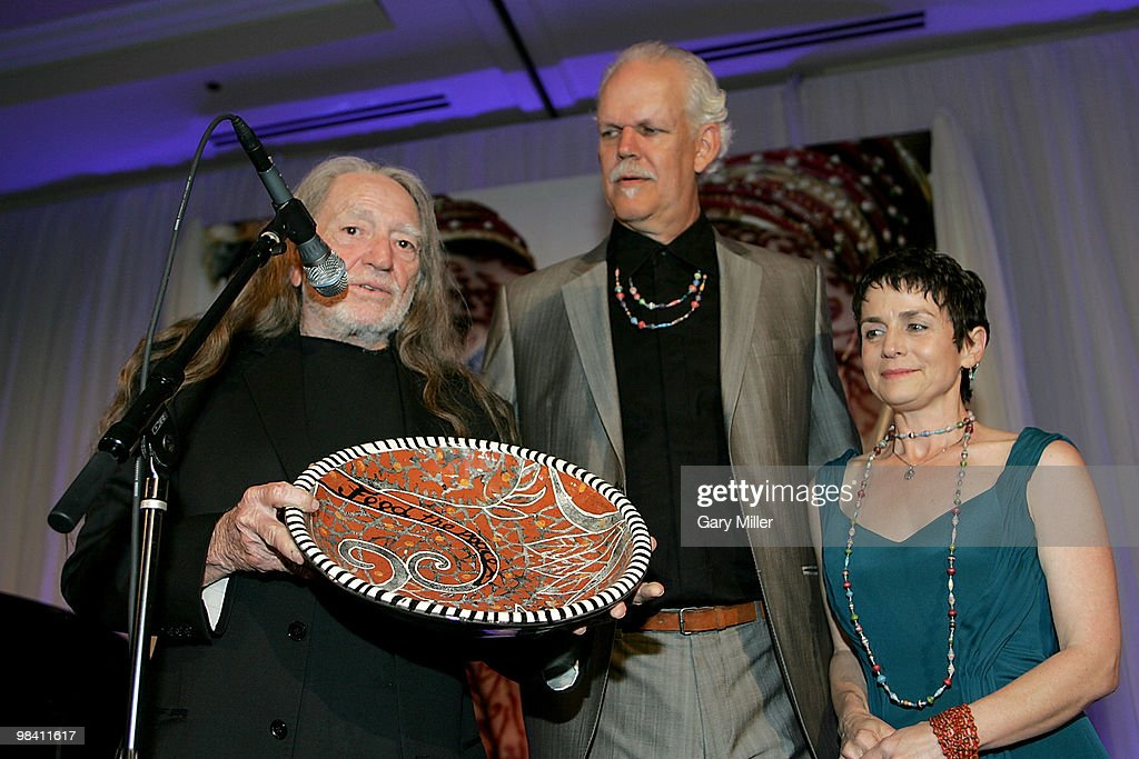 Musician Willie Nelson, social activist/author/filmmaker Turk Pipkin and Christy Pipkin present the Nobelity Project's 'Feed The Peace' award to Willie at the Four Seasons Hotel on April 11, 2010 in Austin, Texas.