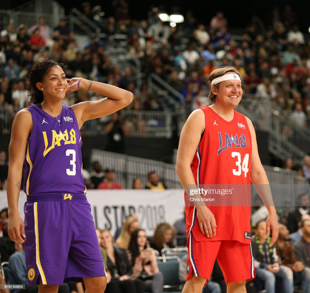 Musician Win Butler and Candace Parker of the Los Angeles Sparks laugh during the 2018 NBA All-Star Game Celebrity Game as part of 2018 NBA All-Star Weekend on February 16, 2018 at Verizon Up Arena in the Los Angeles Convention Center in Los Angeles, California.