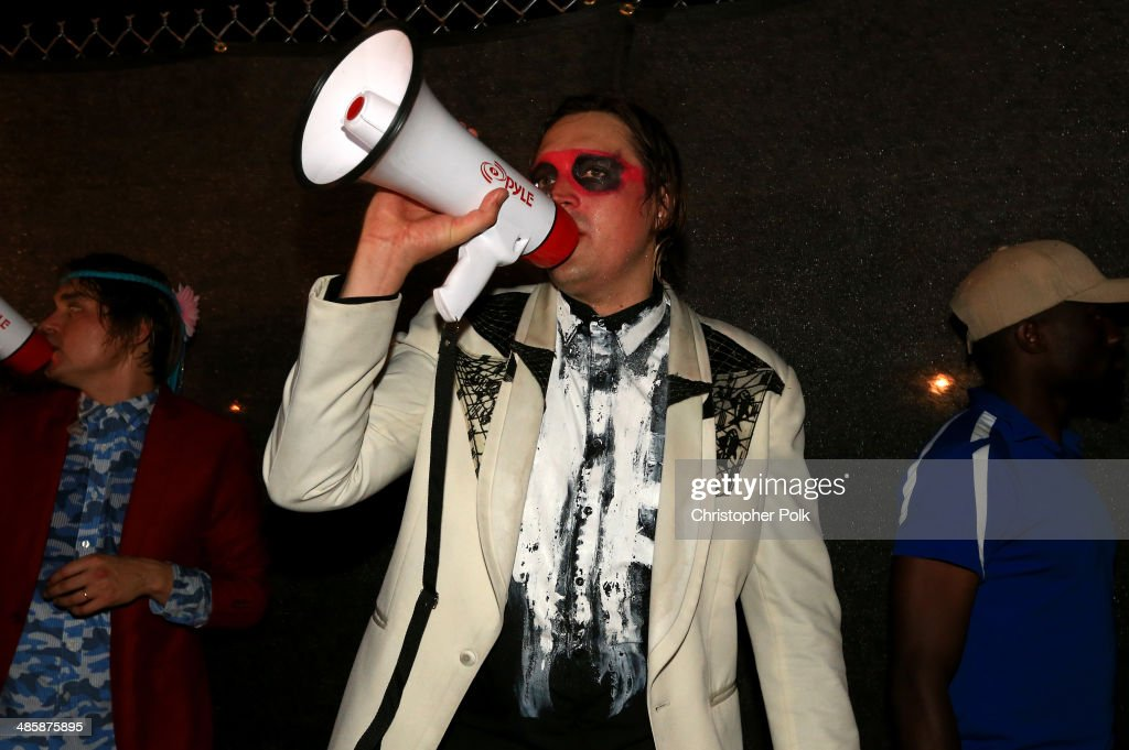Musician <a gi-track='captionPersonalityLinkClicked' href=/galleries/search?phrase=Win+Butler&family=editorial&specificpeople=2220917 ng-click='$event.stopPropagation()'>Win Butler</a> of Arcade Fire performs in the crowd during day 3 of the 2014 Coachella Valley Music & Arts Festival at the Empire Polo Club on April 20, 2014 in Indio, California.