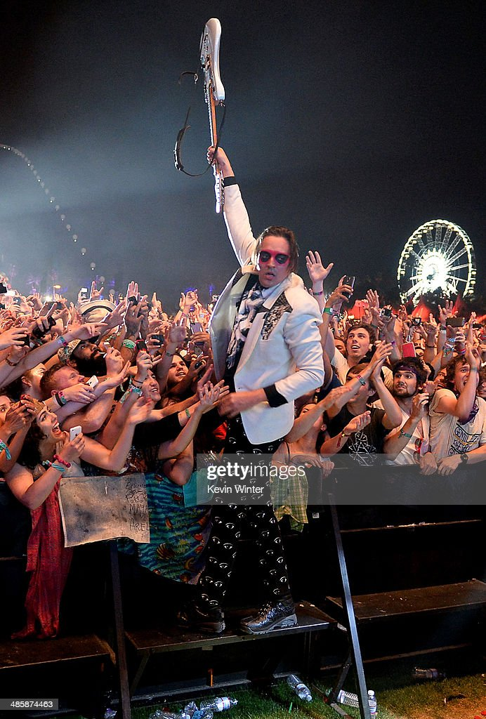 Musician <a gi-track='captionPersonalityLinkClicked' href=/galleries/search?phrase=Win+Butler&family=editorial&specificpeople=2220917 ng-click='$event.stopPropagation()'>Win Butler</a> of Arcade Fire performs onstage during day 3 of the 2014 Coachella Valley Music & Arts Festival at the Empire Polo Club on April 20, 2014 in Indio, California.