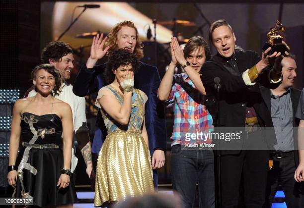 Musician Win Butler Regine Chassagne and the band Arcade Fire accept Album of the Year award for 'The Suburbs ' onstage during The 53rd Annual GRAMMY...