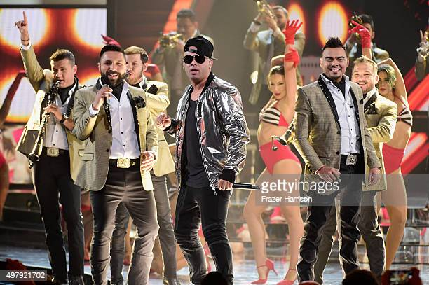 Musician Wisin performs with members of Banda El Recodo onstage during the 16th Latin GRAMMY Awards at the MGM Grand Garden Arena on November 19 2015...