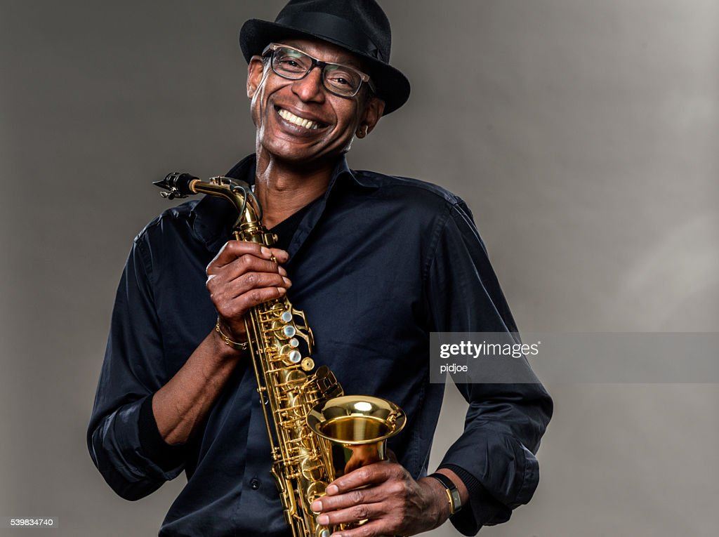 Musician with saxophone and big smile : Stock Photo
