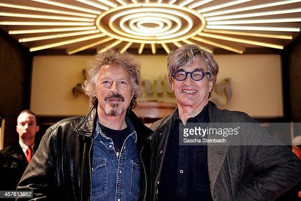 Musician Wolfgang Niedecken and director Wim Wenders attend the premiere of the film 'Das Salz der Erde' at Lichtburg on October 21 2014 in Essen...